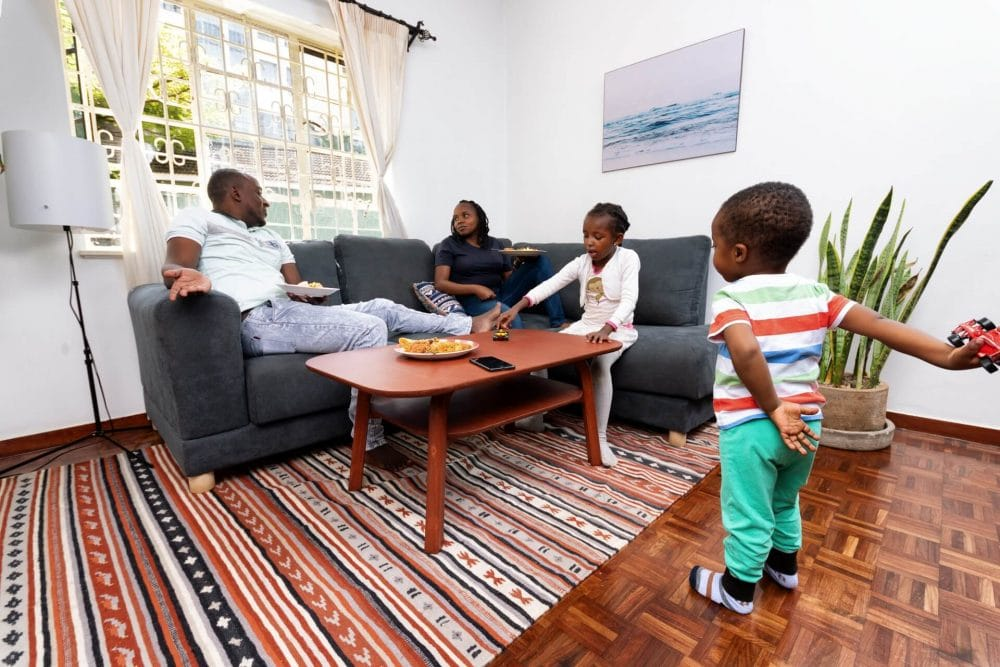 A family sitted on Moko's Jiji 5 seater placing food on Moko's Coffee table