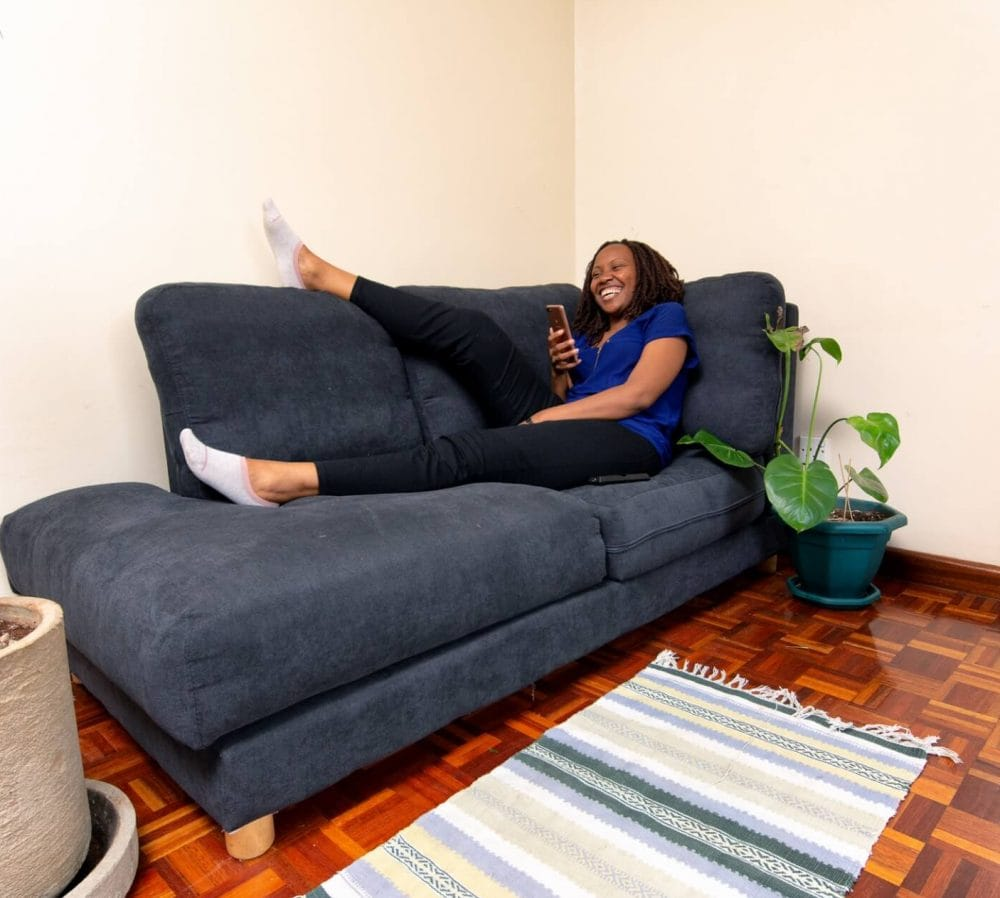 A lady laying on a Moko Jilaze Chaise 2 Seater