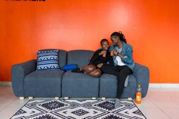 couple seated on a Moko sofa