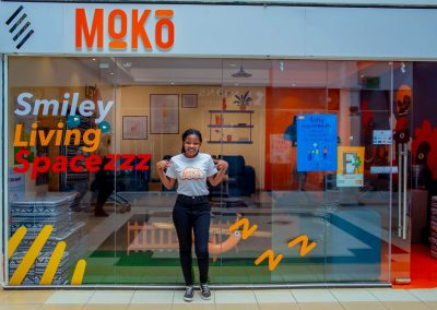 A lady standing outside the Moko showroom at Capital Centre