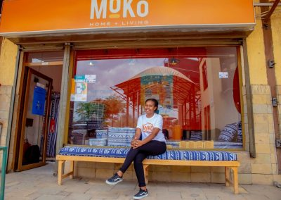 A Lady sitting outside Moko Point Mall Shop
